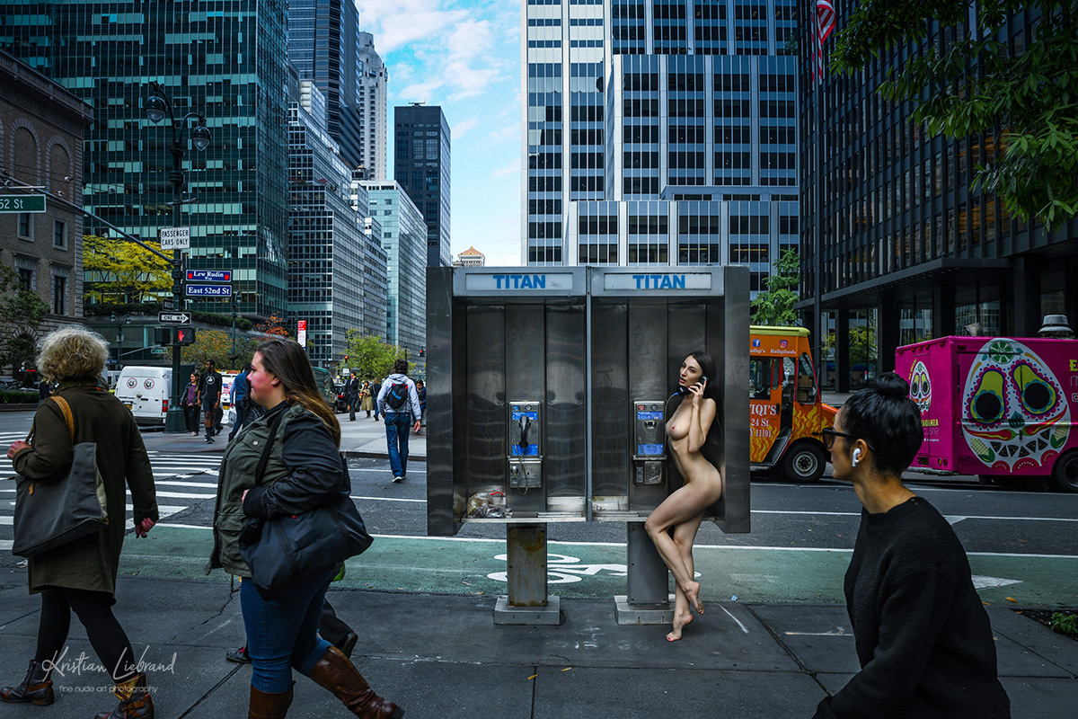 Phone Booth Titan in the streets of New York city - Nude naked Model in public artwork gallery